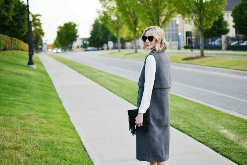 free people vest, bow blouse, black fringe bag