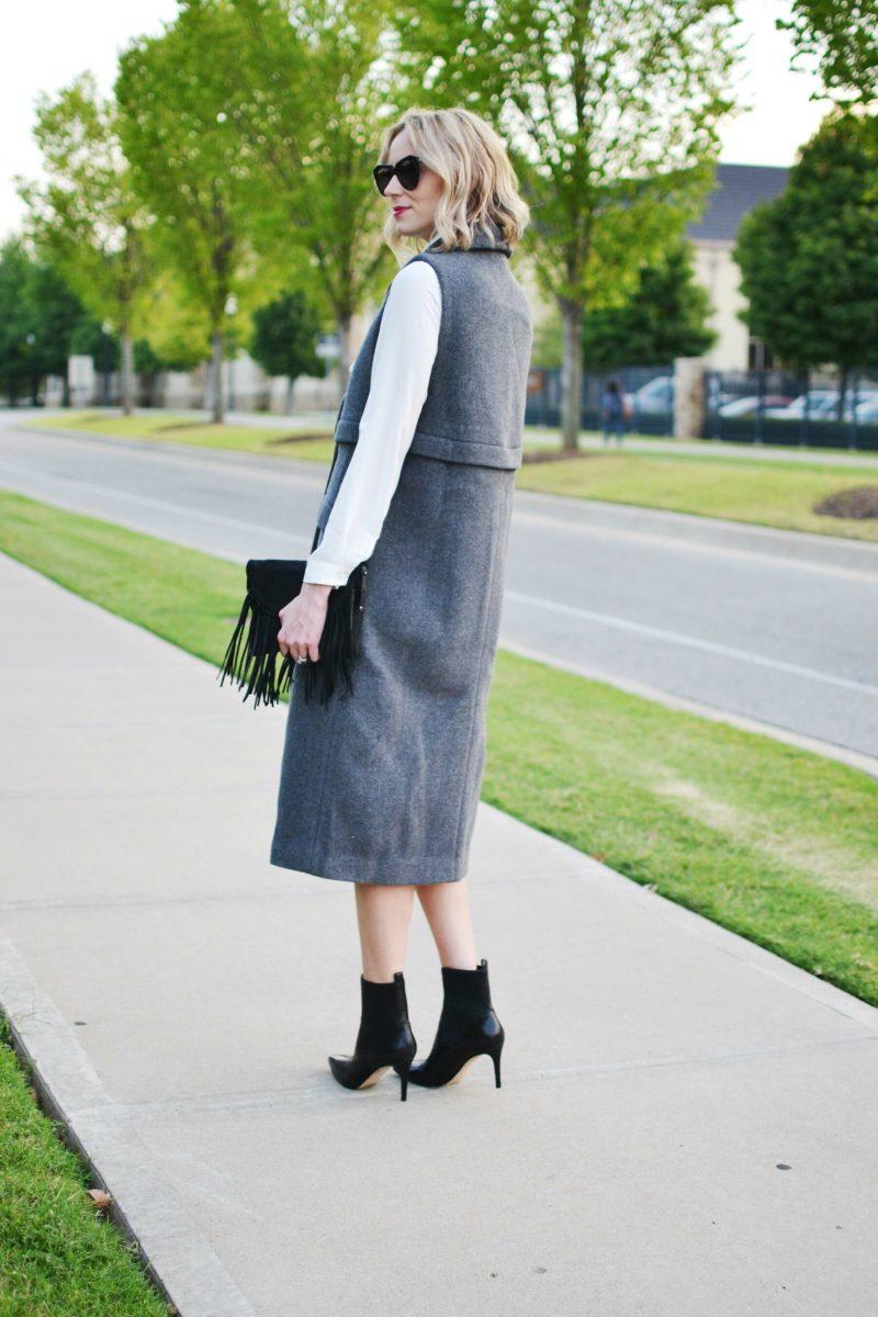 free people vest, bow blouse, heeled booties, fringe bag