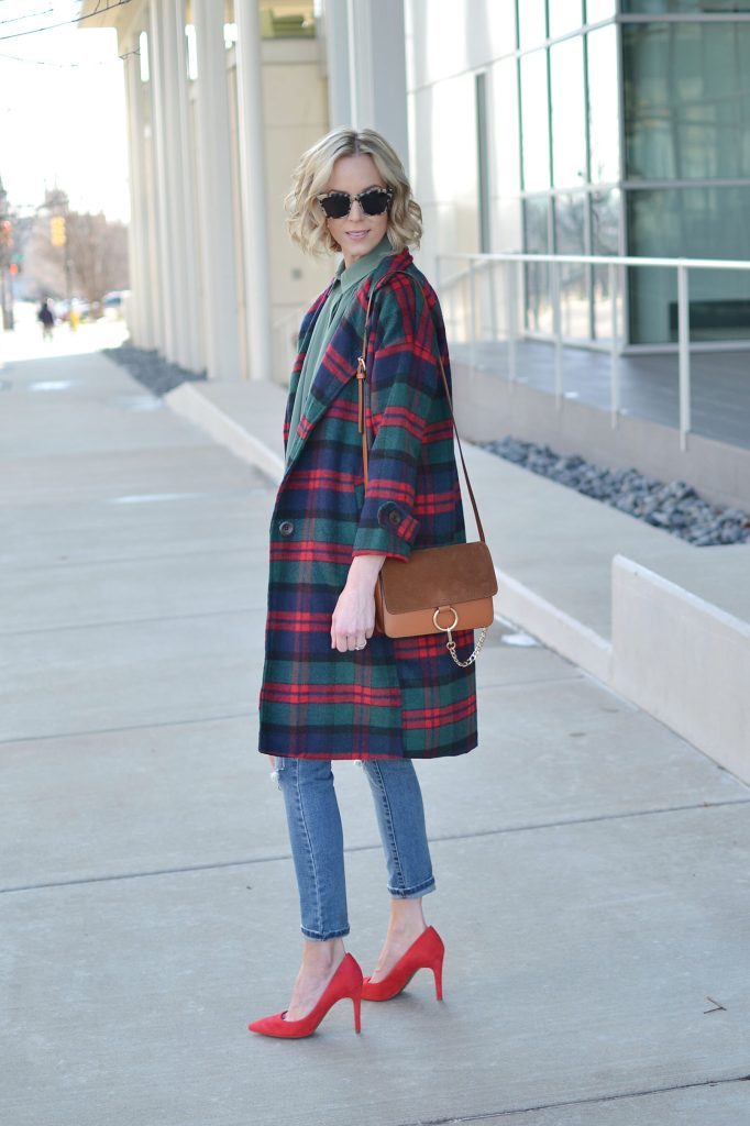 Isaac Mizrahi blouse and red heels, plaid coat, distressed jeans, chloe dupe bag