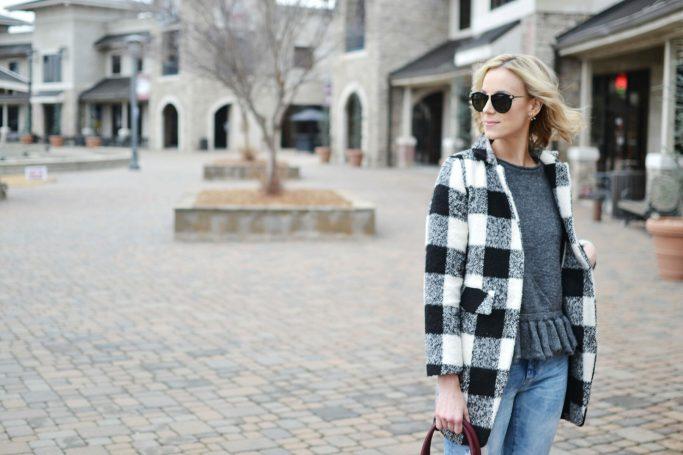 ruffle hem sweater, plaid coat, distressed jeans