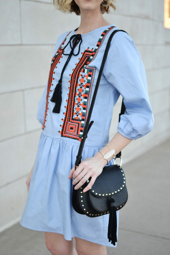blue embroidered dress with tassel tie and Chloe dupe bag