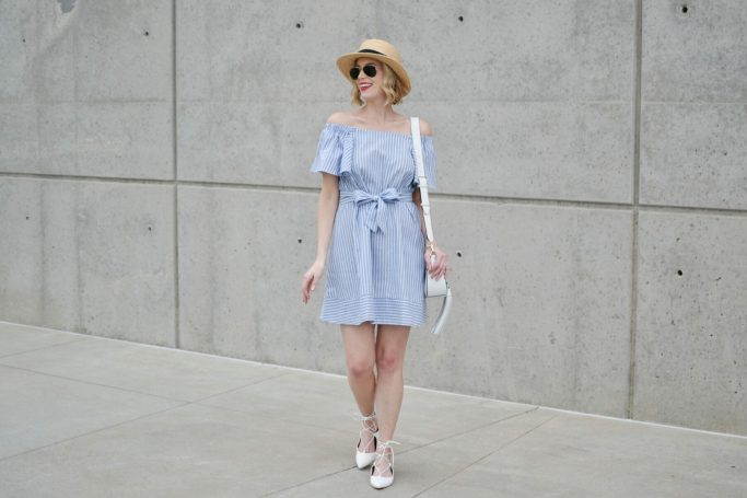 blue and white striped off the shoulder dress, white lace up flats, white tassel bag, star hat, red lip