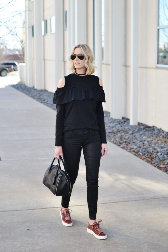 how to wear all black, coated black jeans, cold shoulder top, blush velvet sneakers