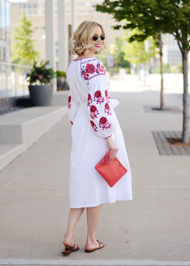 white and red embroidered midi dress with tassel tie closure