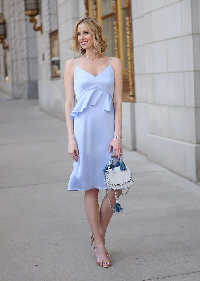 unique peplum waist dress, baby blue, dressy dress, event outfit, Rebecca minkoff tassel bag