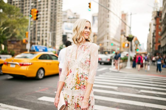 floral and lace feminine dress with blush clutch, new york street style photo