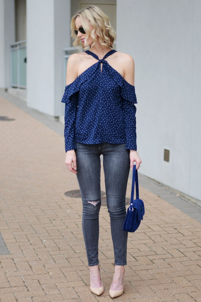 cutest going out top with grey jeans and nude heels, navy blue cold shoulder halter top