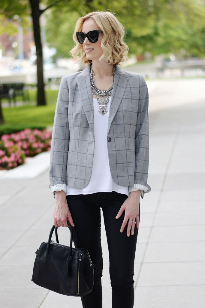 modern way to style a grey blazer, white layered cami, black coated skinny jeans, silver necklace