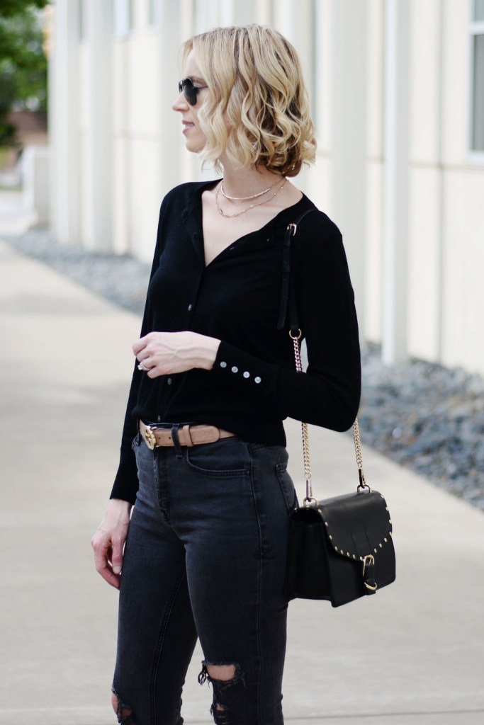 how to wear a cardigan as a top, all black outfit, gucci belt, distressed black jeans, black cardigan