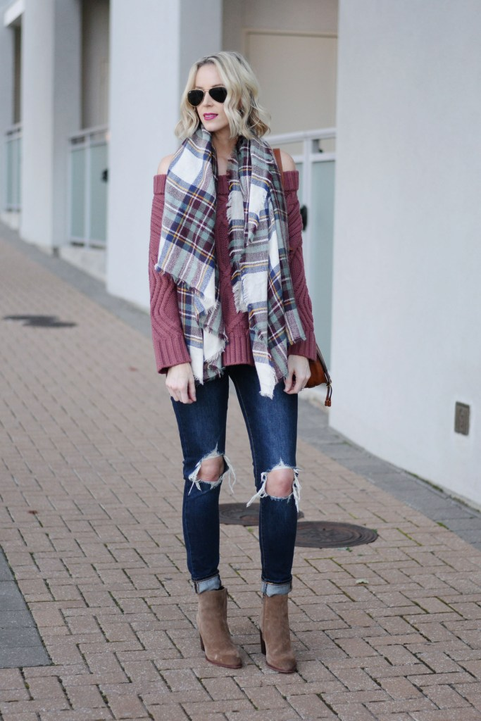 plaid blanket scarf with OTS sweater, ripped jeans, boots