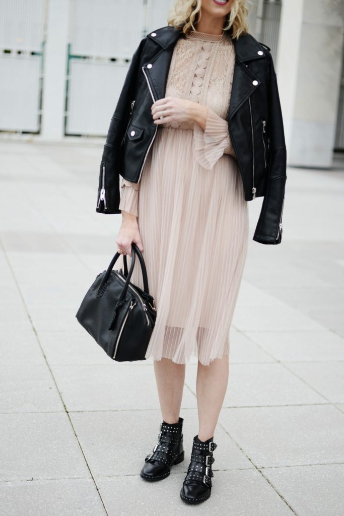 nude tulle overlay dress with edgy black moto jacket and boots