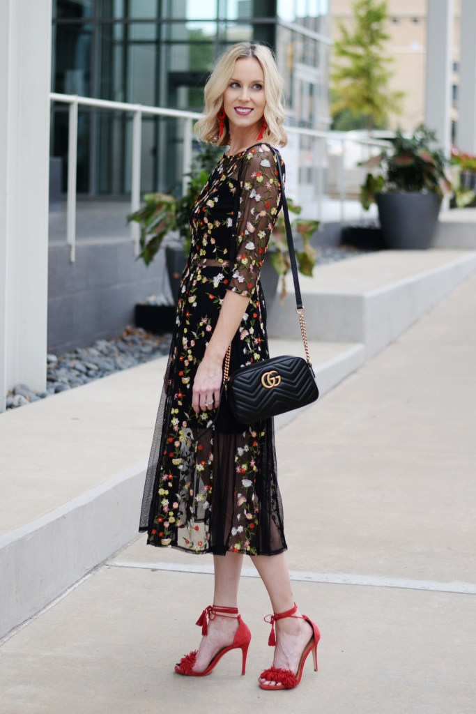 dressy cocktail outfit idea for cooler months, midi dress and heels, dark floral, lace up red heels, gucci bag