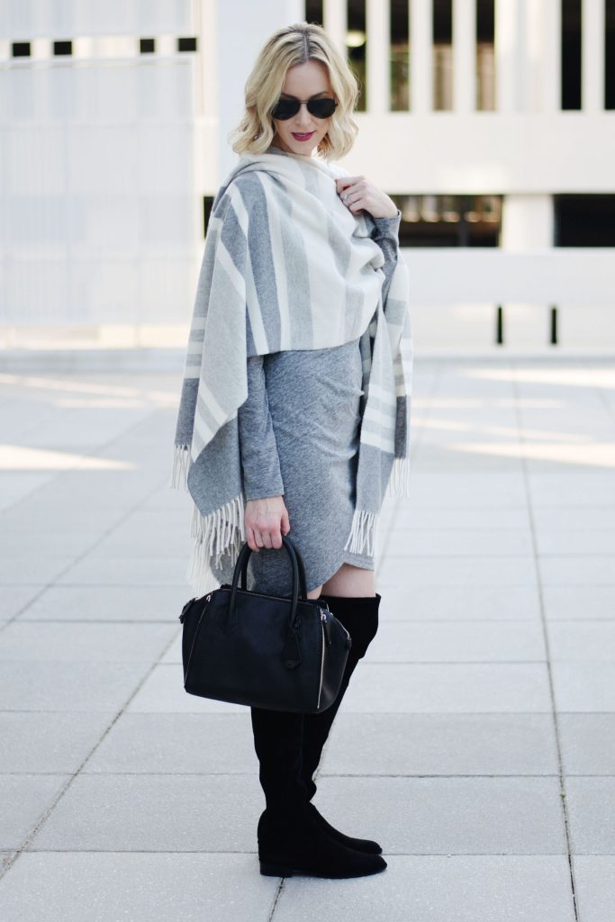 how to style a poncho with a dress, grey ruched dress with black over the knee boots and grey striped poncho worn as a wrap, how to wear a poncho