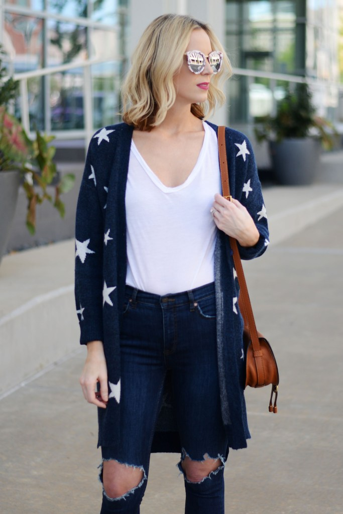 mirrored sunglasses with a white t-shirt and star cardigan