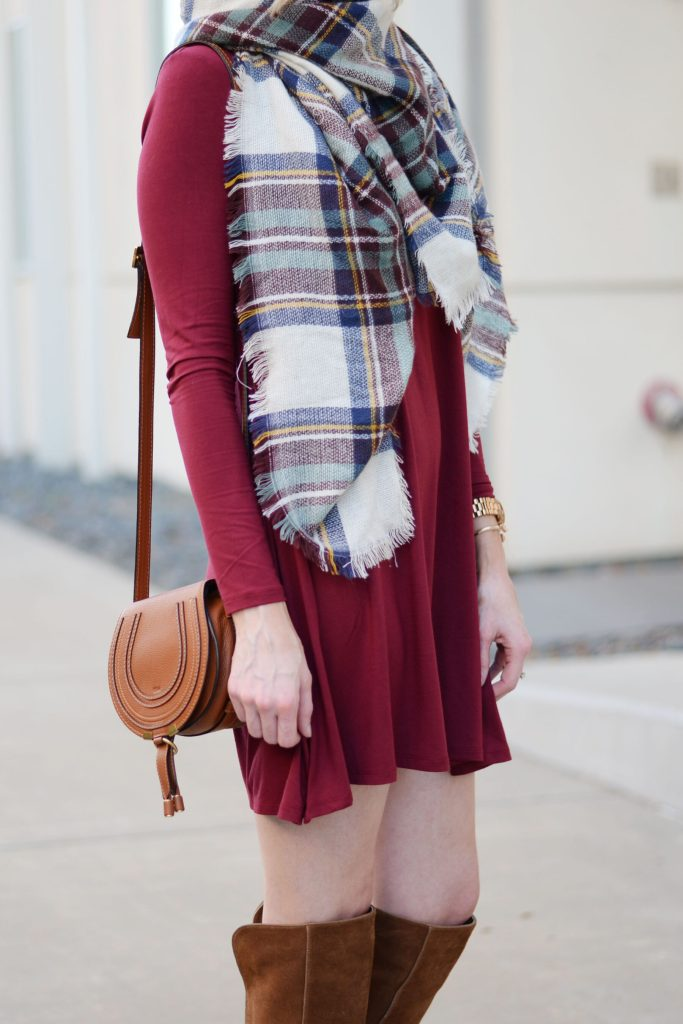 burgundy dress with cognac boots and bag styled with plaid scarf