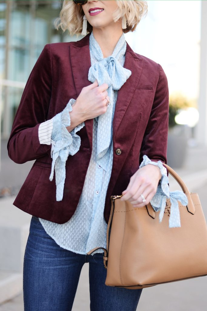 blue tie blouse and wine colored velvet blazer, tassel earrings