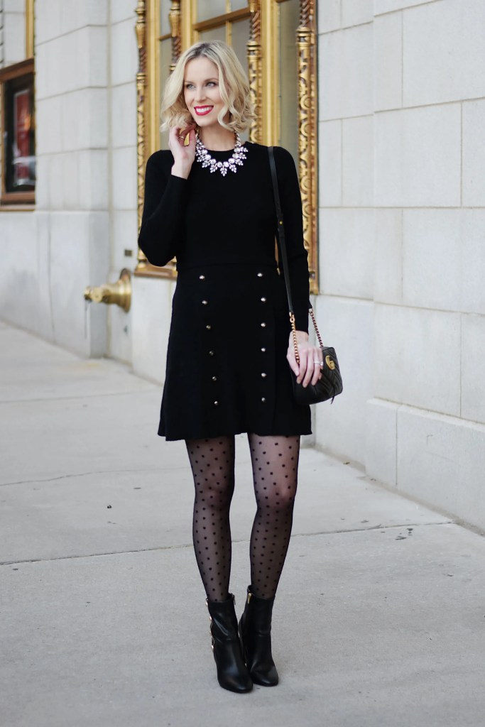 black sweater dress with gold buttons, polka dot tights, black boots
