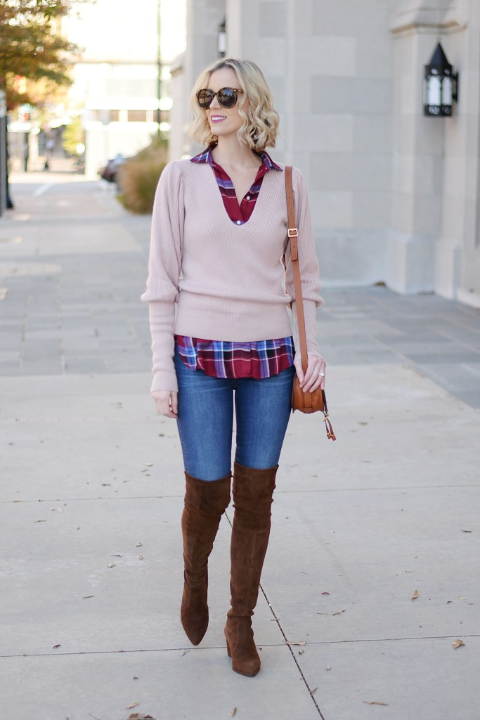 sweater and plaid top layered together with jeans and brown over the knee boots