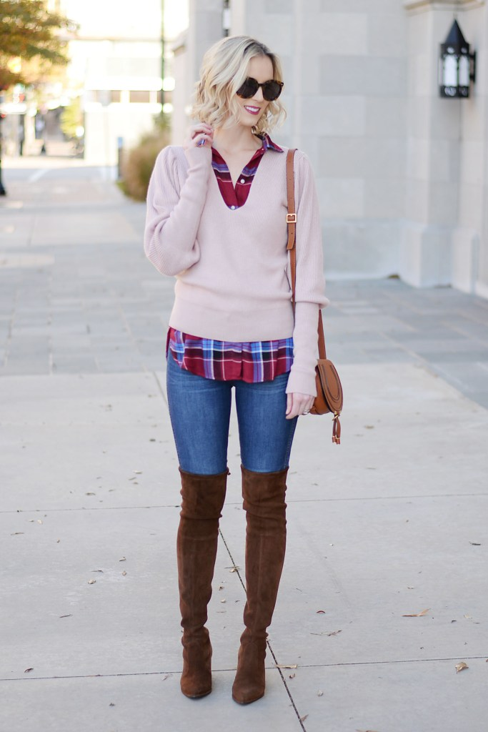 burgundy and pink tops layered with brown over the knee boots and jeans