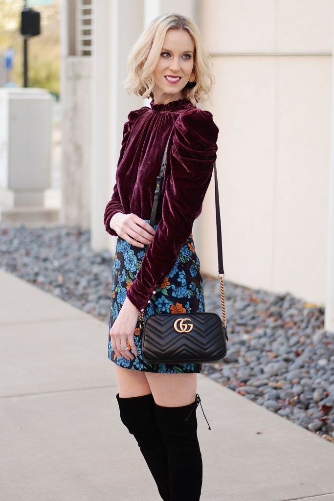 gorgeous wine colored velvet top with puff sleeves and pearl buttons, jacquard floral skirt, gucci marmont bag, black over the knee boots