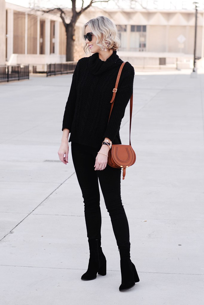 the most slimming outfit - black jeans with black sock booties to make a long leg line