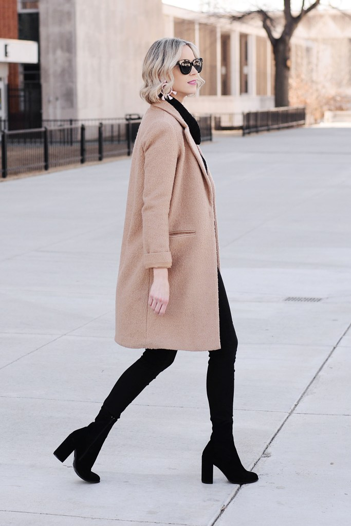all black outfit with tan topcoat and black sock booties