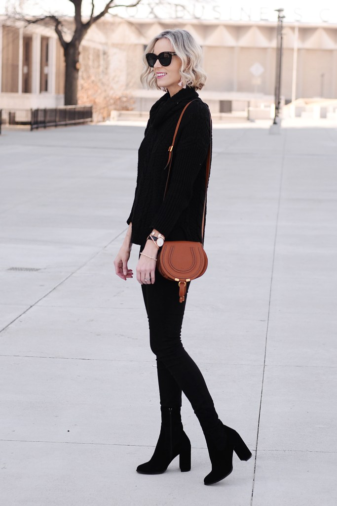 all black outfit with tan bag, add sock booties to make a long, lean leg line