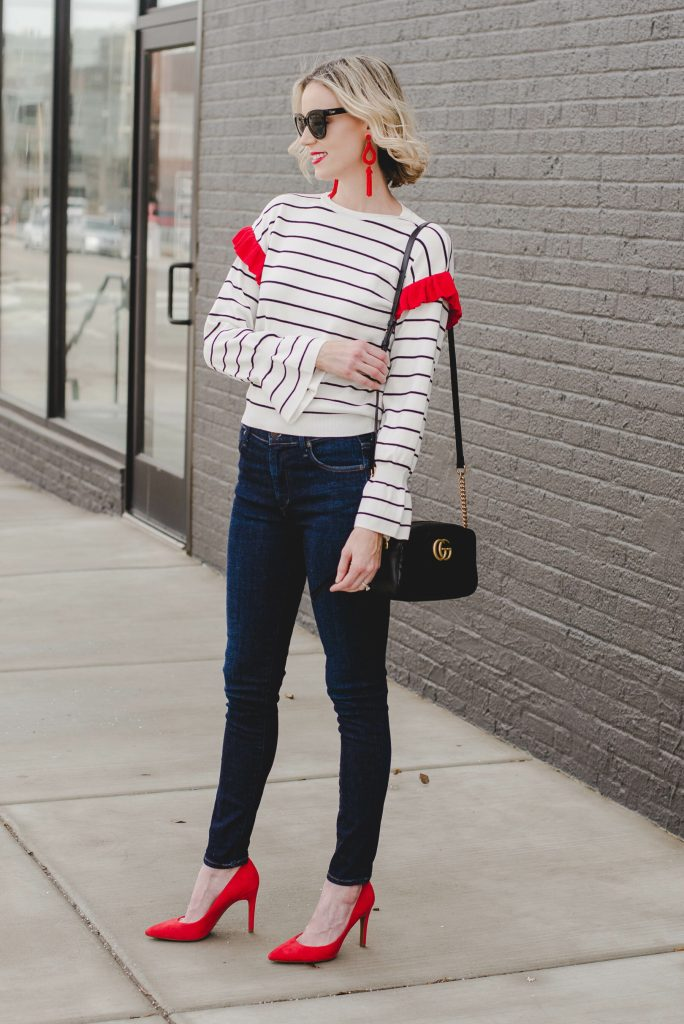 striped top with red ruffle on shoulder