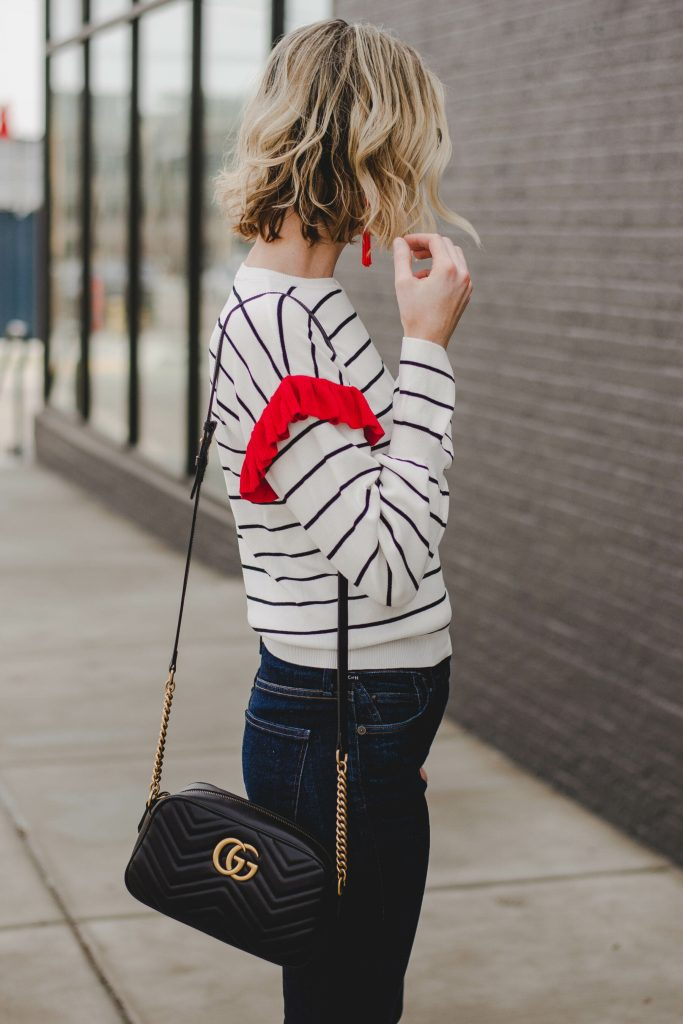 wavy long bob, blonde hair, wavy hair, black and white striped top with red ruffle, gucci bag