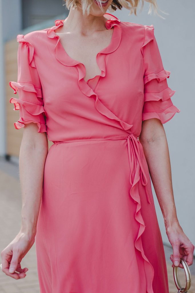 coral wrap dress with ruffle details