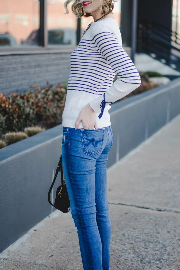 striped sweater with bow detail at arm