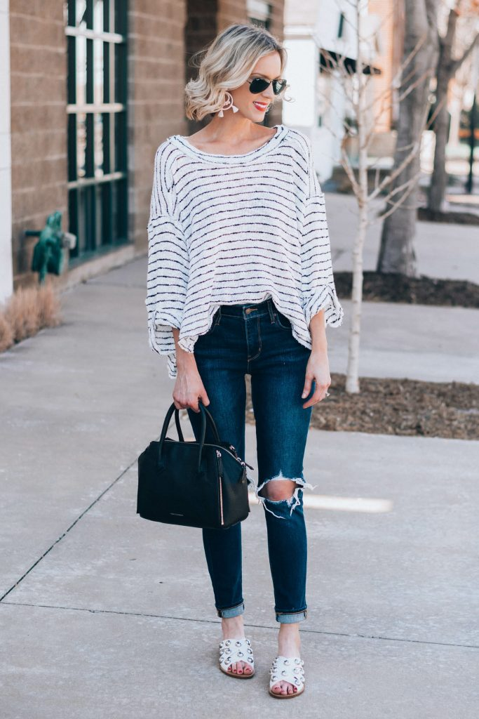 slouchy striped top with busted knee jeans