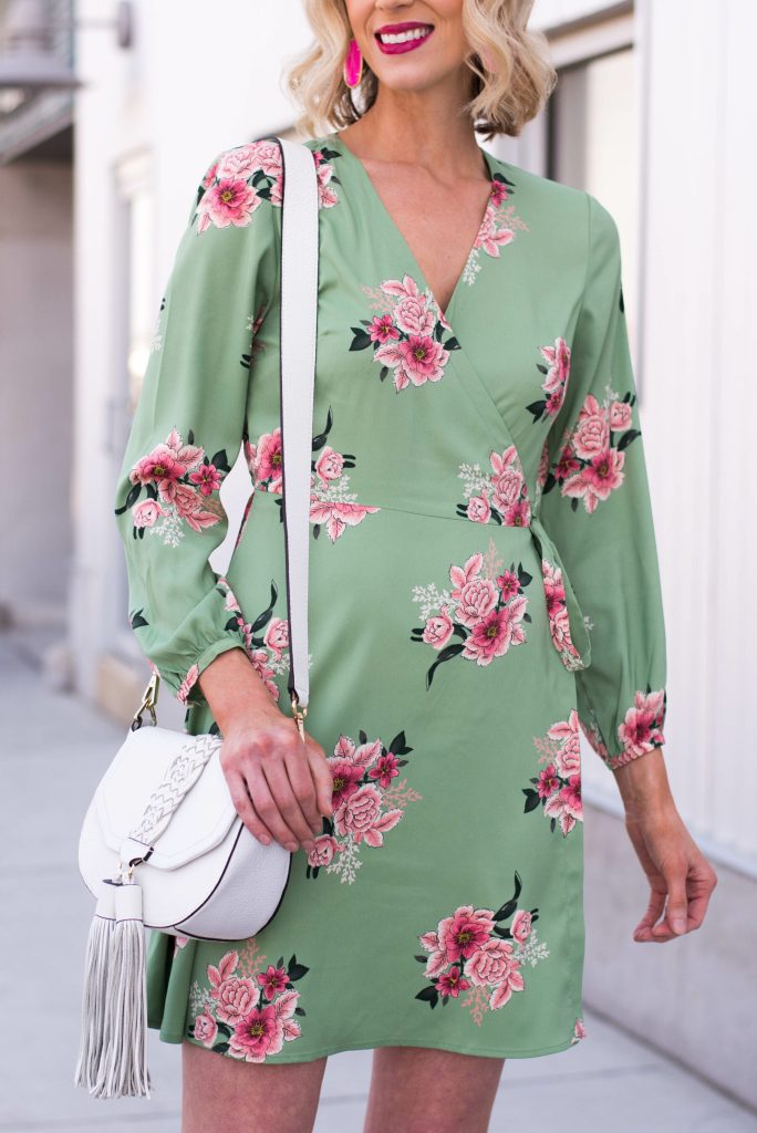 gorgeous soft floral dress with wrap detail and white bag