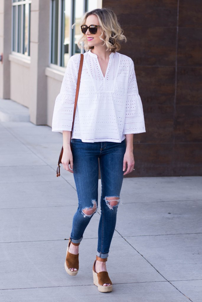 white eyelet top with jeans and cognac wedges and bag