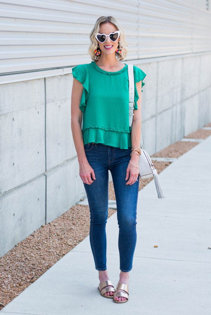 cute green ruffle top, skinny jeans, and gold slides