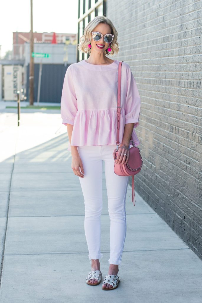 pink peplum top with white jeans and pink accessories