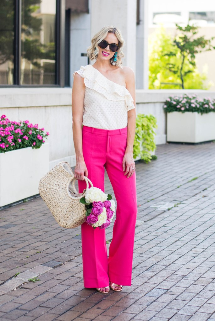 dressy pink pants with one shoulder cream ruffle top