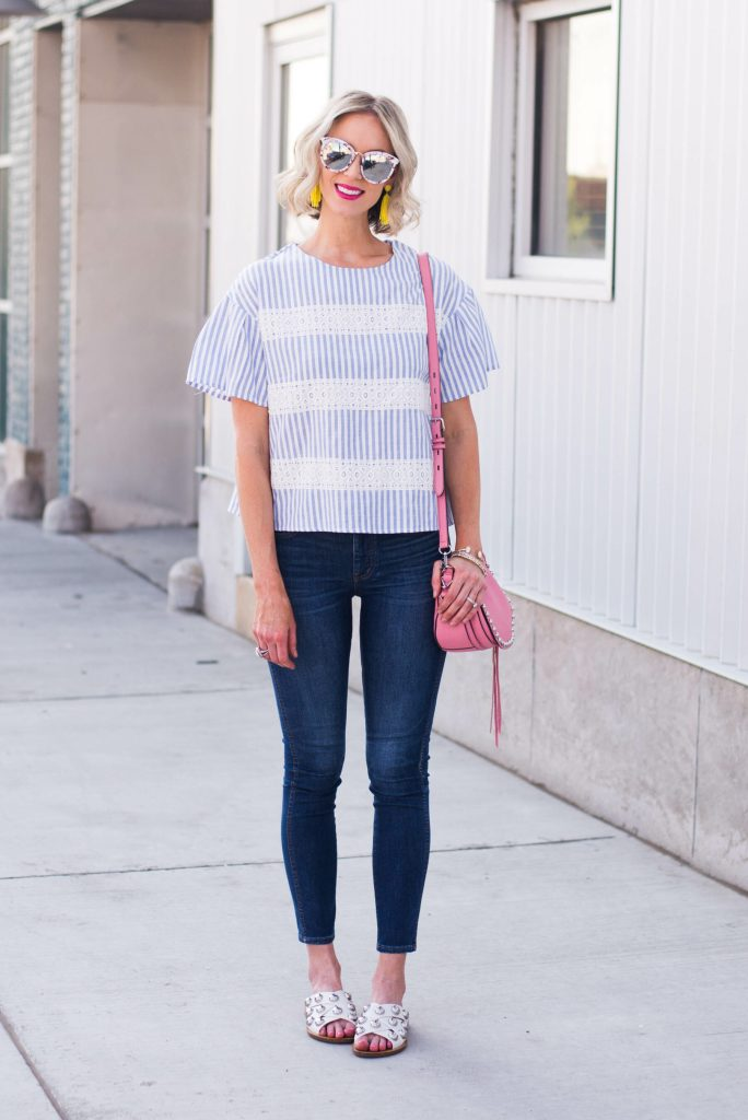 blue and white striped top with skinny jeans