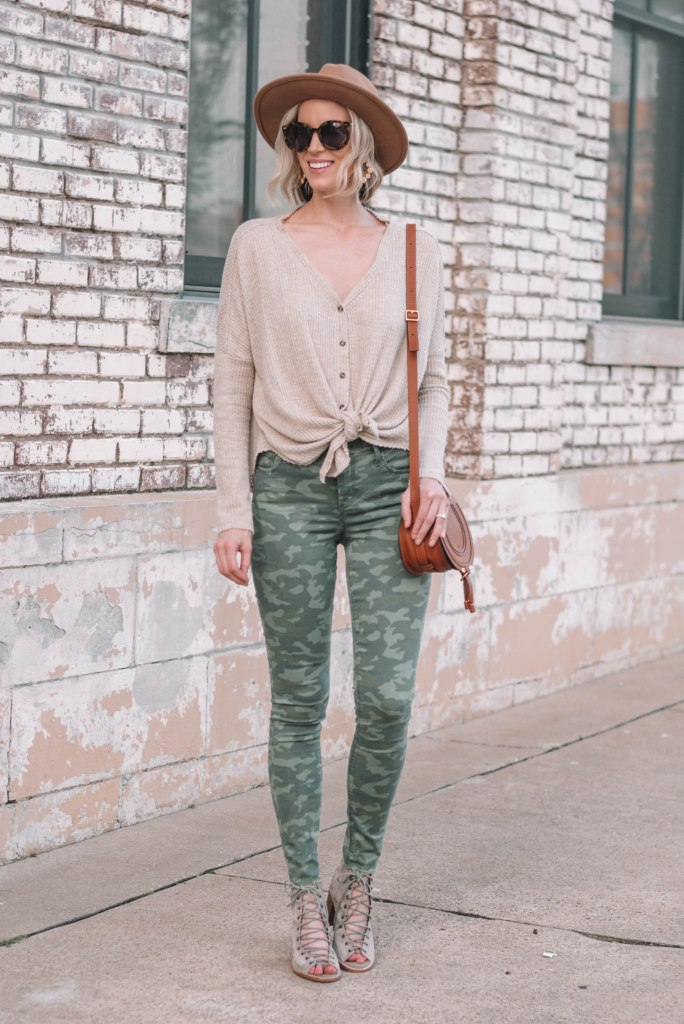 camo jeans styled with a neutral top