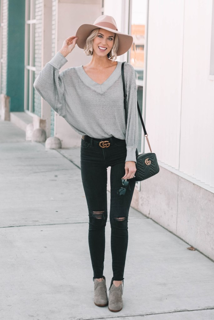 thermal top, black jeans, hat, ankle booties