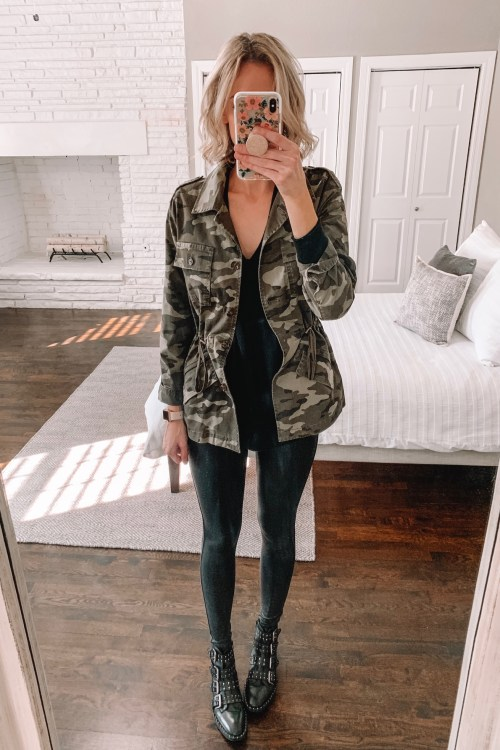 how to wear leggings casually; faux leather leggings with a long layering top, camo jacket, and edgy buckle boots