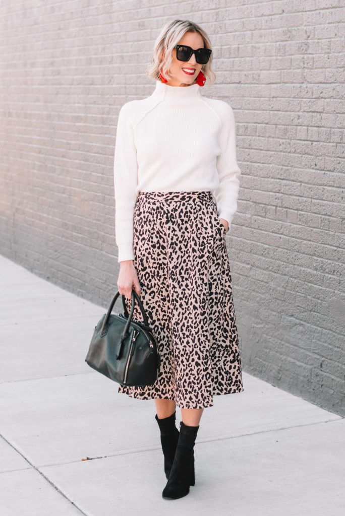 leopard midi skirt with boots and a sweater, stylish work outfit
