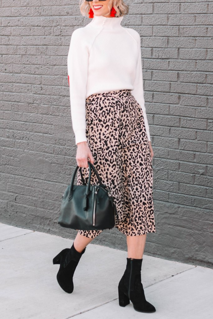 leopard midi skirt styled for work with sweater and sock booties