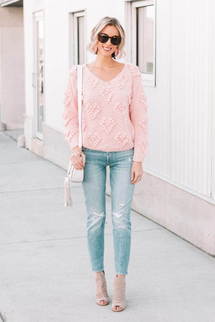 pink heart pom pom sweater