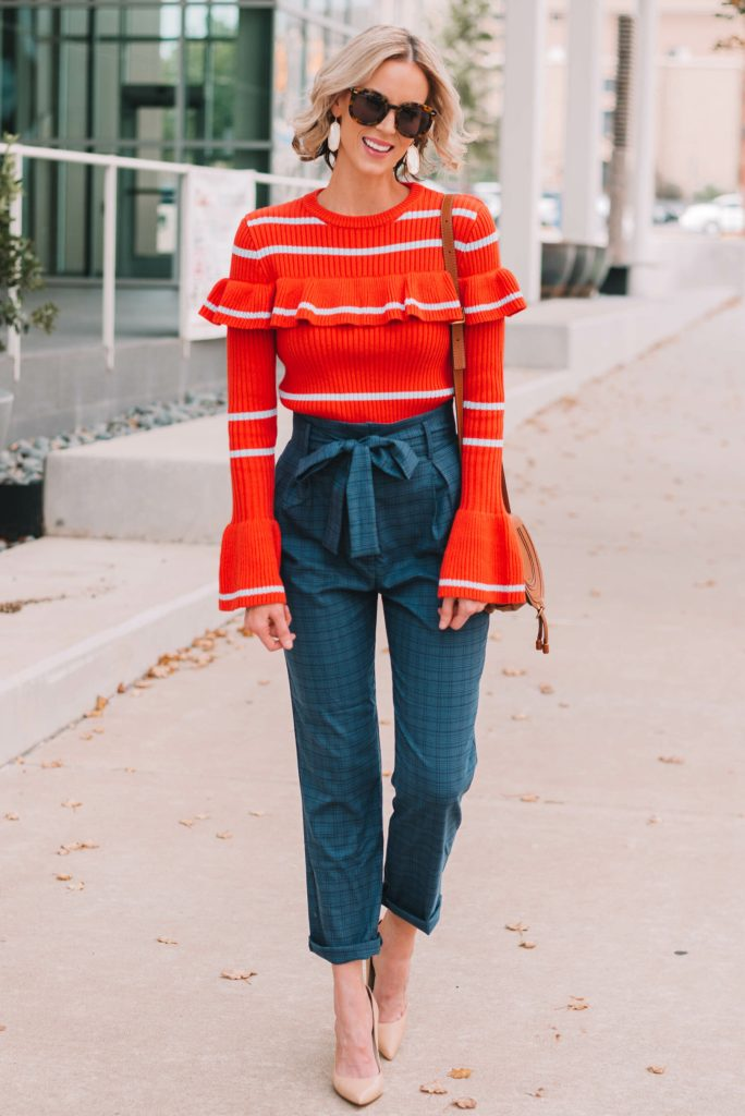 navy paperbag waist pants with orange stripe ruffles sweater, cool work outfit idea