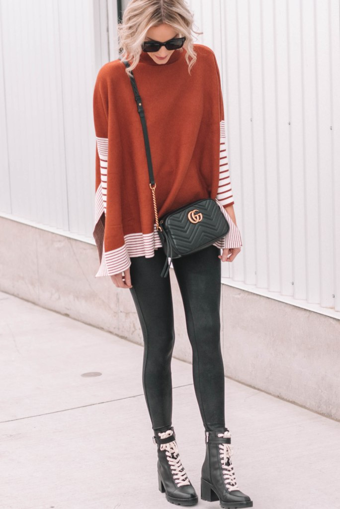 poncho styled with lace up combat boots and leather leggings for edge