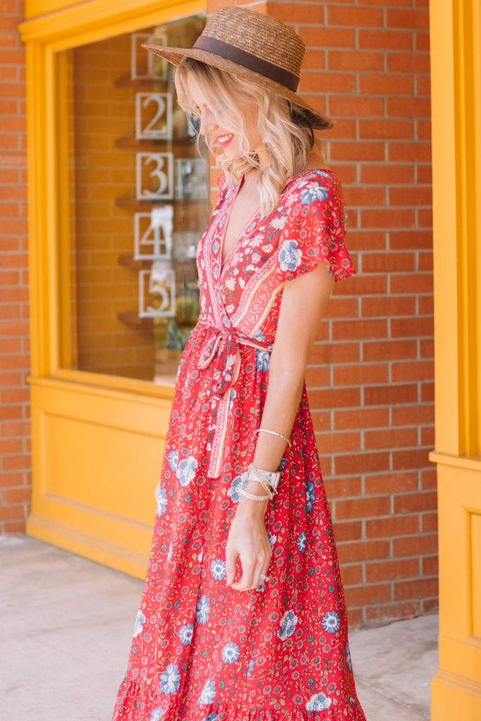 gorgeous red wrap maxi dress and straw hat