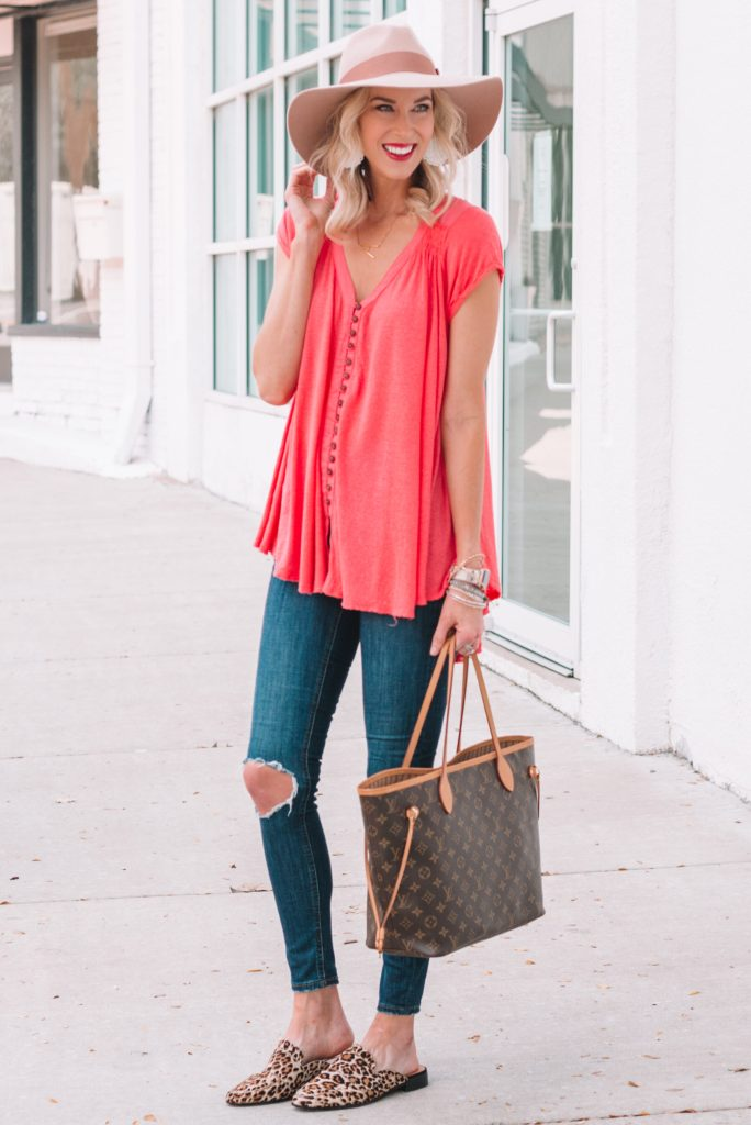 long tunic style shirt with jeans and a hat