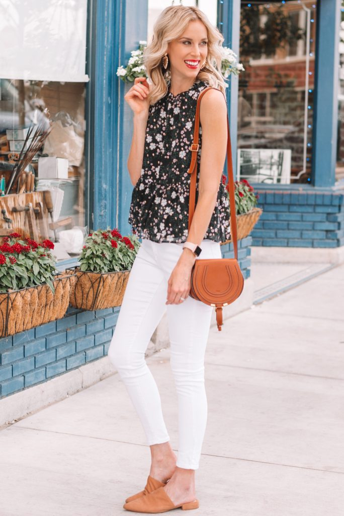 dark floral peplum top and white jeans for summer can be easily transitioned to fall