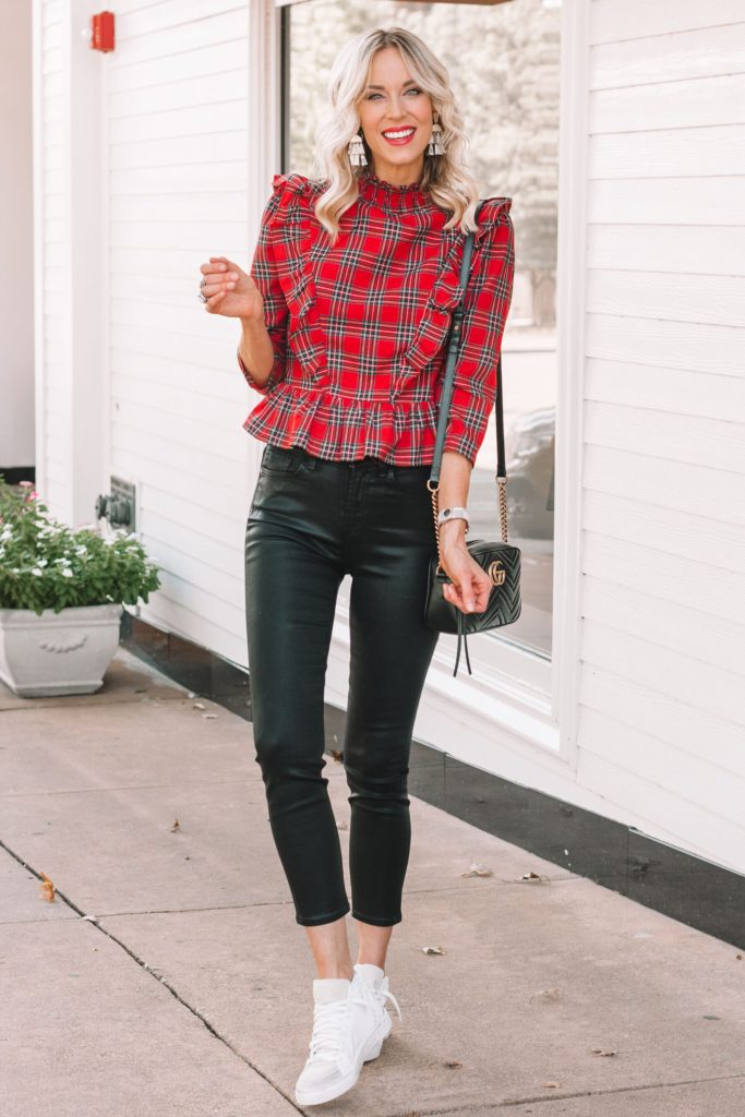 coated black jeans with red plaid top and golden good dupe sneakers